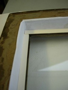 The glass was taped into the frame with white, acid-free, gummed tape to keep out dust and thrips.